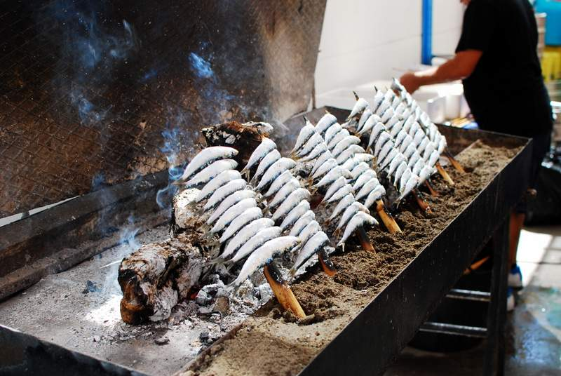 Offbeat Spain Malaga Feria grilled sardines