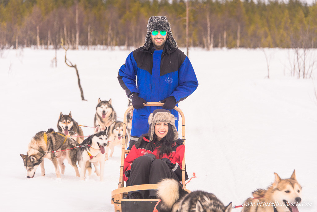 Us on husky sled in Rovaniemi