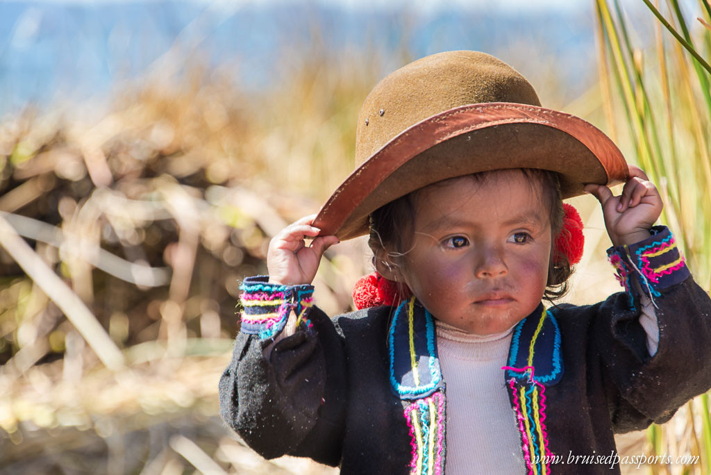 Peru Itinerary-South America-lake-titicaca-uros-islands-baby
