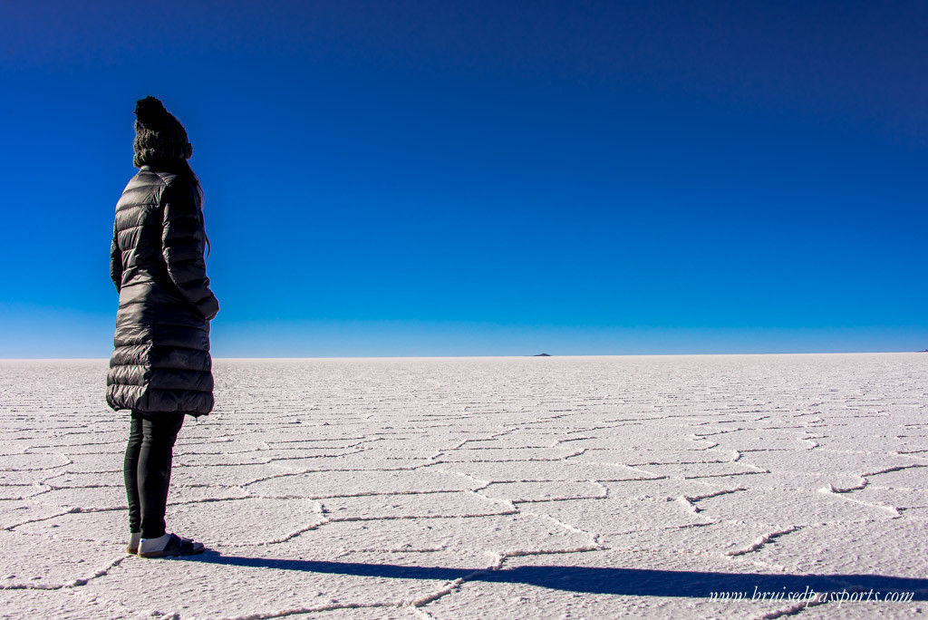 Girl standing in the middle of Salar De Uyuni Bolivia
