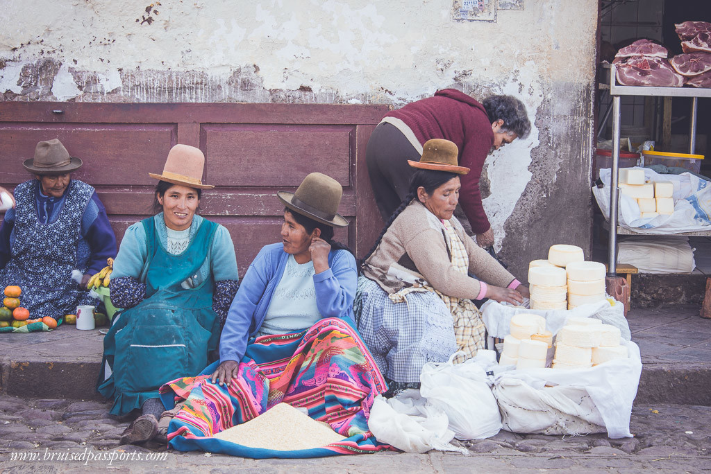 Women selling whole grains at a local market in Peru