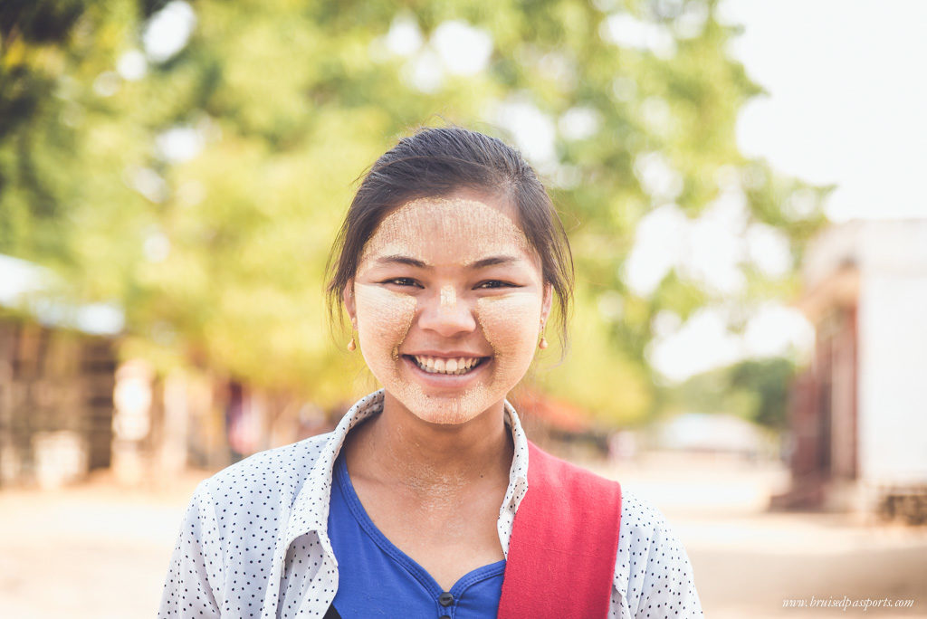 Myanmar smiling girl with thanaka paste on her face