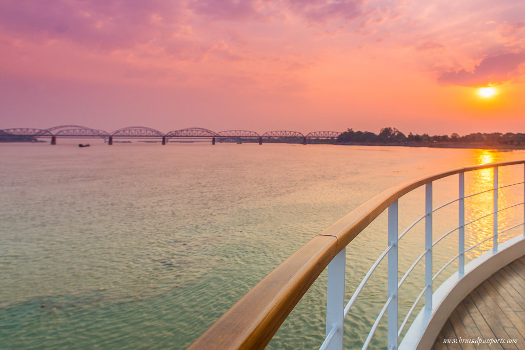 The sun sets as we cruise down the Irrawaddy river