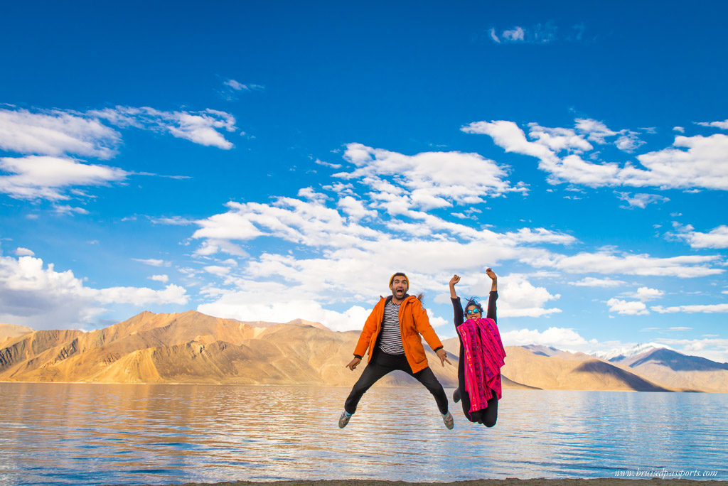 Ladakh road trip couple at Pangong Lake