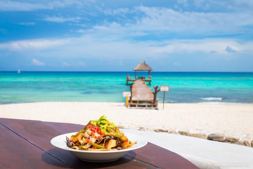 nachos and guacamole by the beach in Playa Del Carmen