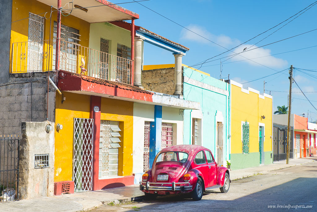 Merida vintage car and colourful houses