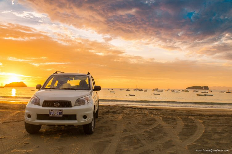 Playa Del Coco Costa Rica sunset at beach with car