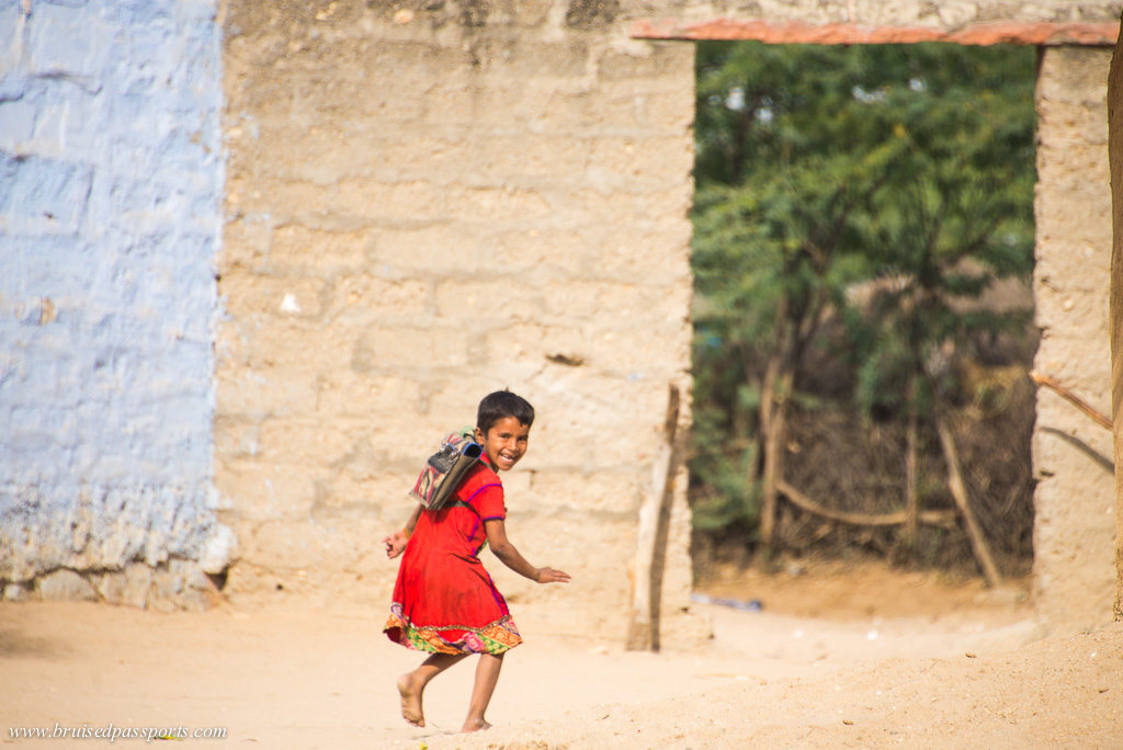 girl running to school in Rajasthan