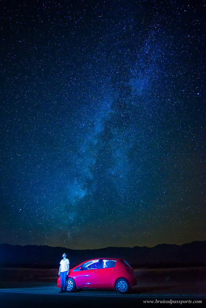 Night sky milky way with car in Death Valley National Park