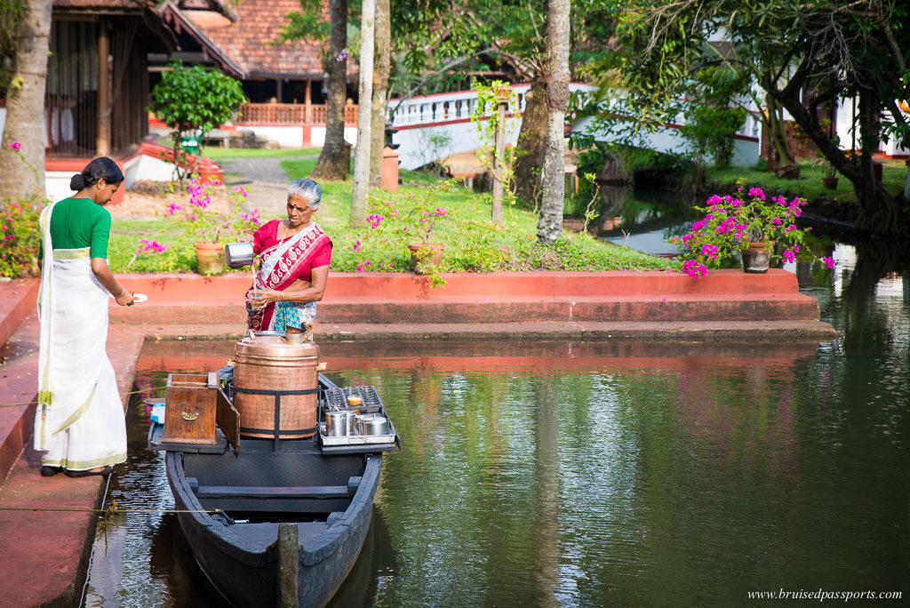 cgh coconut lagoon kerala tea lady in a boat