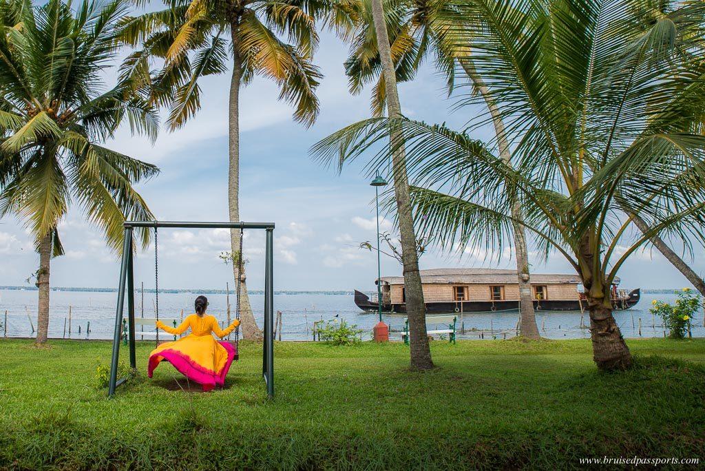 girl at the iconic backwaters of Kerala at Kumarakom