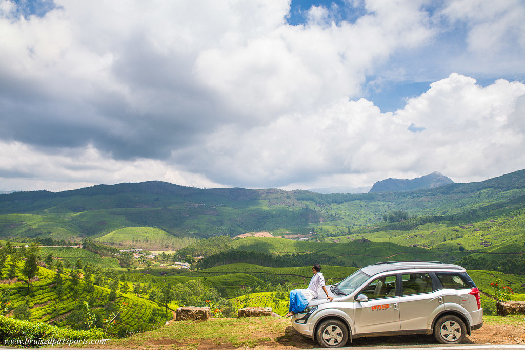 Boy on car in road trip of Kerala