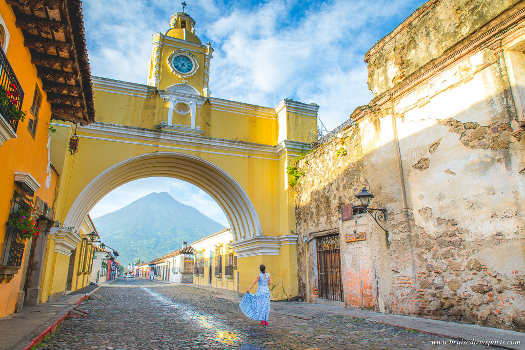 Sunrise at Santa catalina arch and clock tower in Antigua Guatemala