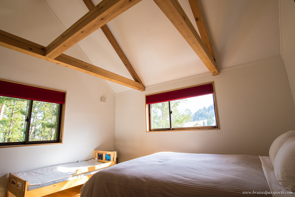 Bedroom with a view at Alps View Chalet Hakuba