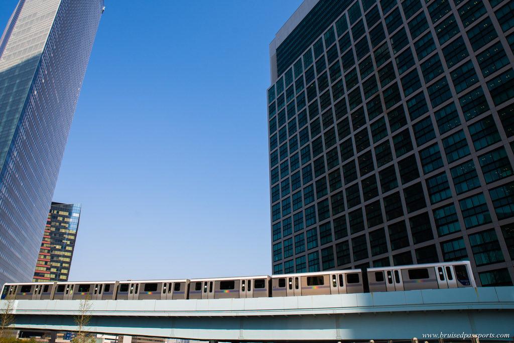 Tokyo mono rail passing between Tokyo's skyline