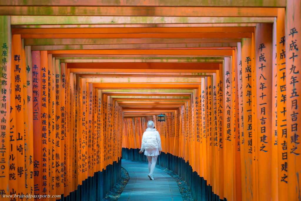 Girl in Inari shrine in Kyoto