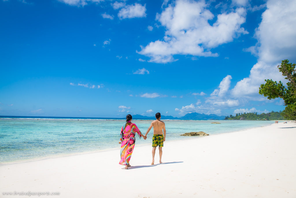 Couple on a beach in Labriz Seychelles