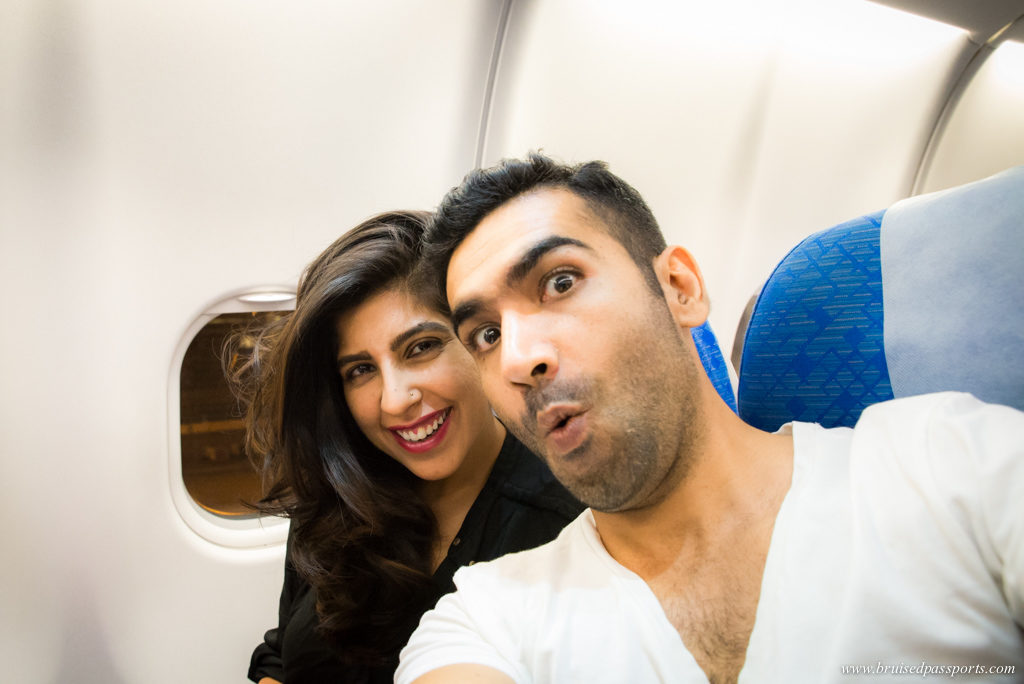 couple in Cathay Pacific airways to Hong Kong