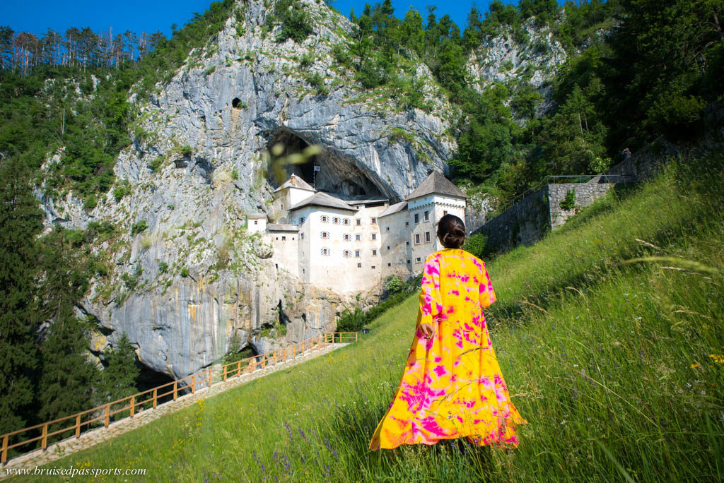 Girl at Predjama castle in Slovenia