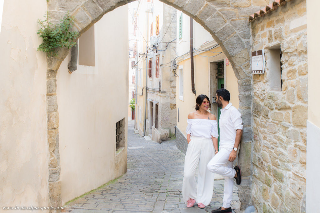 Couple in old town of Piran