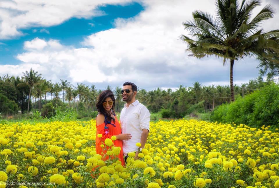 couple in sunflower fields mysore ooty highway