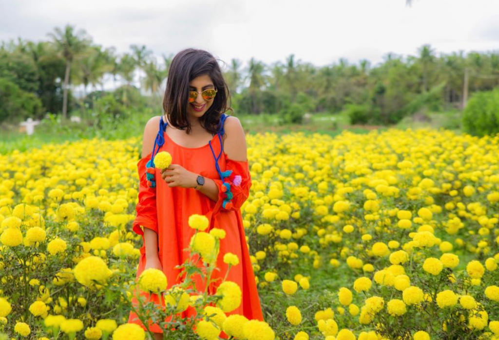 girl in flower field photoshoot fashion karnataka