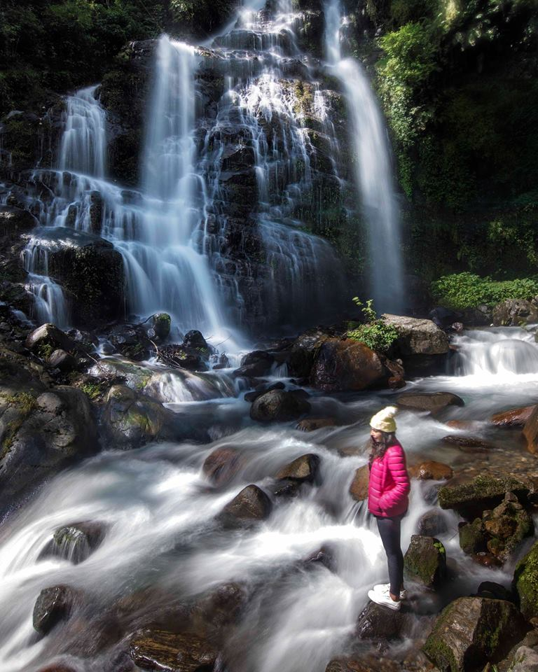 Girl at Kanchenjunga waterfalls in West Sikkim near Pelling