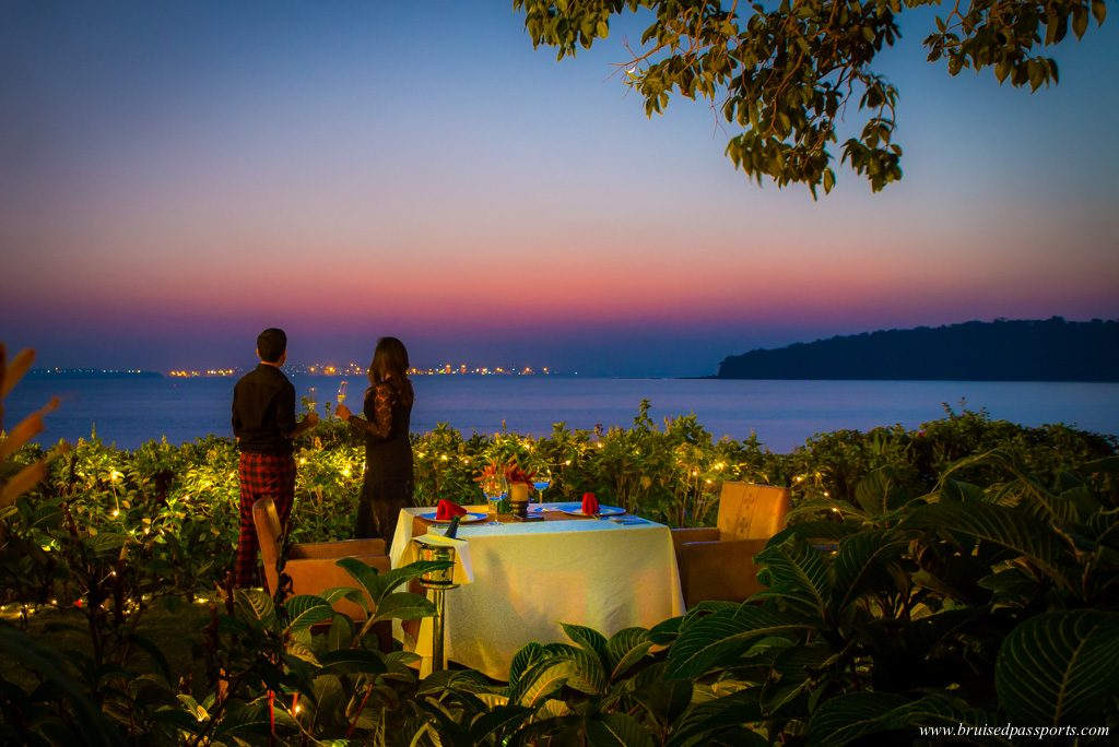 couple at sunset dinner in Grand Hyatt Goa