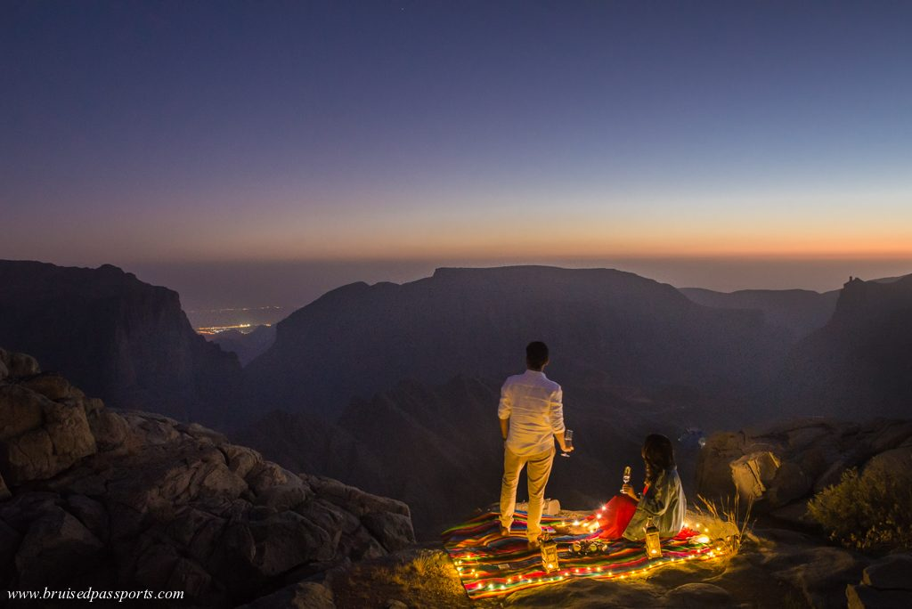 Couple enjoying tea at sunset in Oman