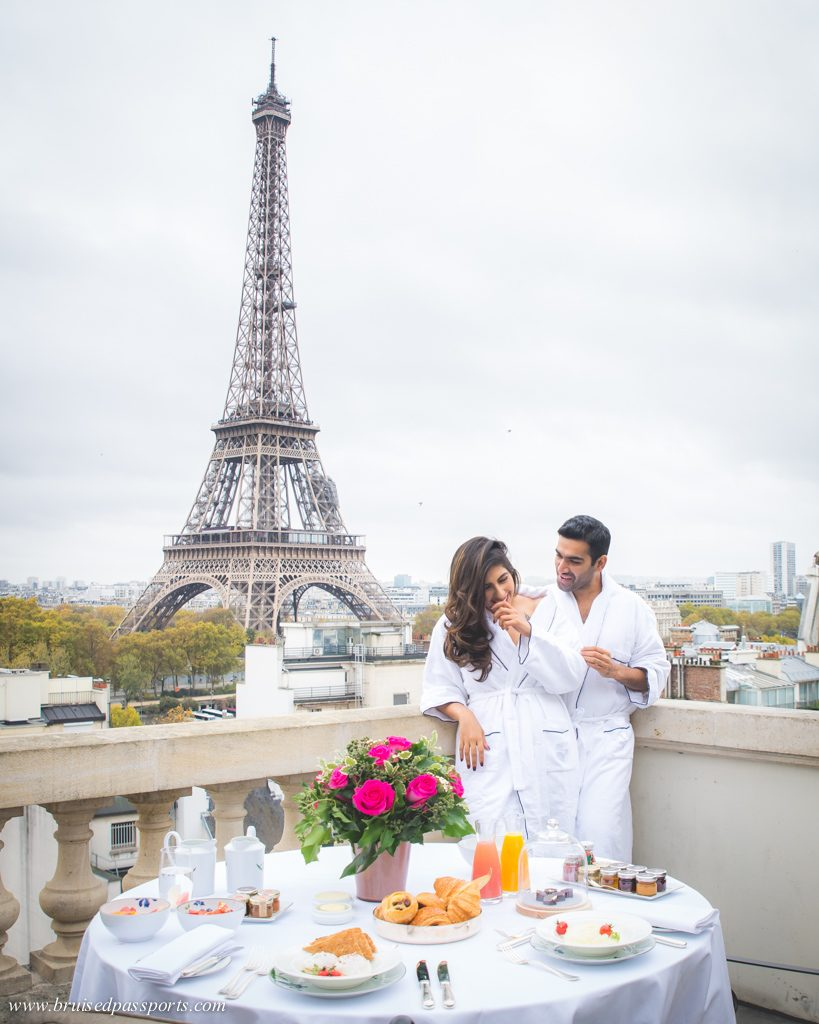 Couple enjoying breakfast with a view of Eiffel Tower