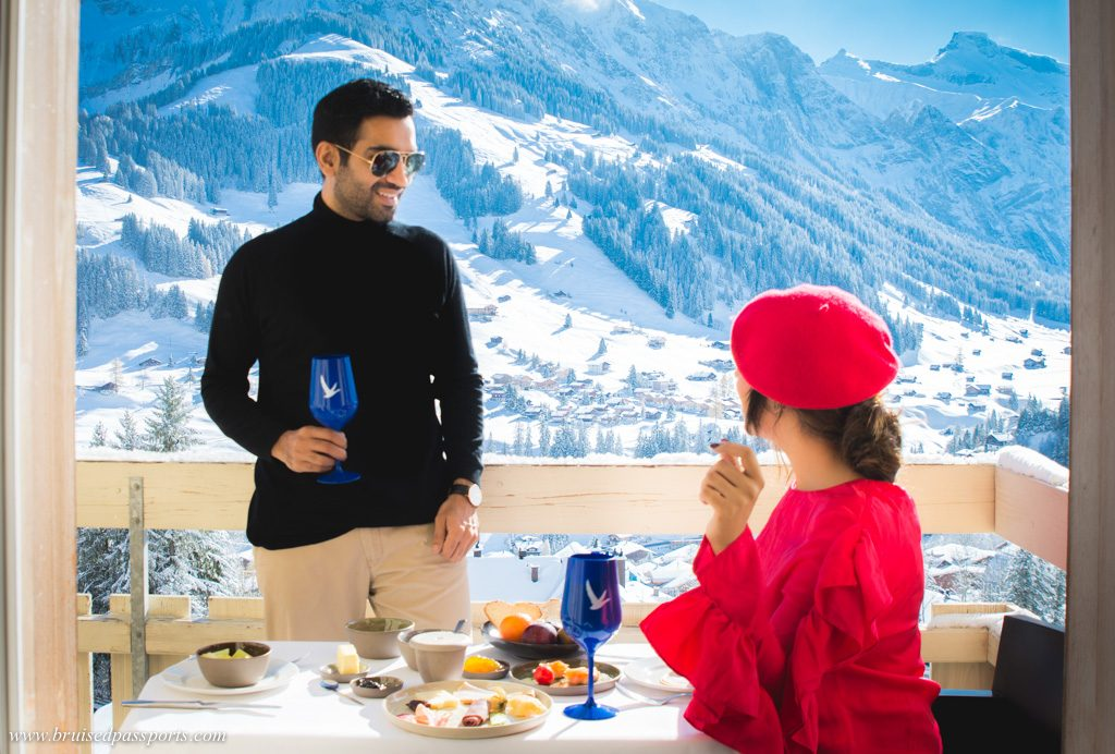 couple enjoying breakfast in snow at Adelboden, Switzerland