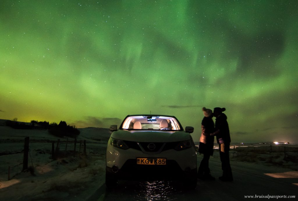 Couple under Northern Lights in ICeland