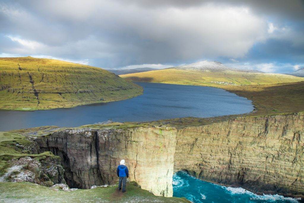 Traelanipa cliff in Vagar island of Faroe Islands where lake appears above ocean