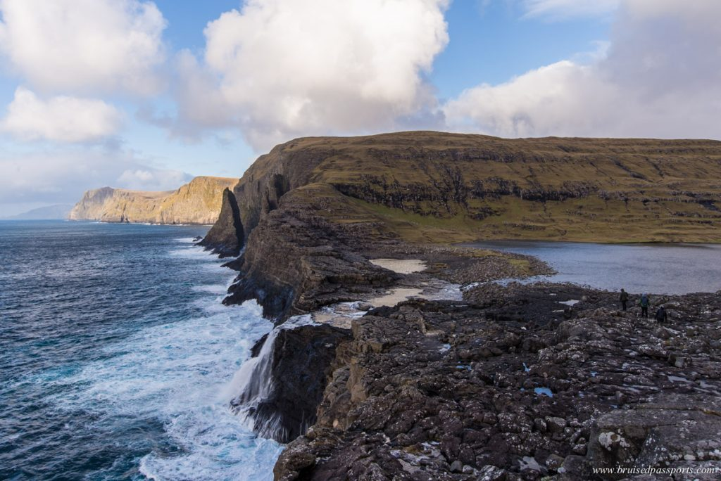 Bøsdalafossur waterfall at the edge of a lake in Faroe Islands