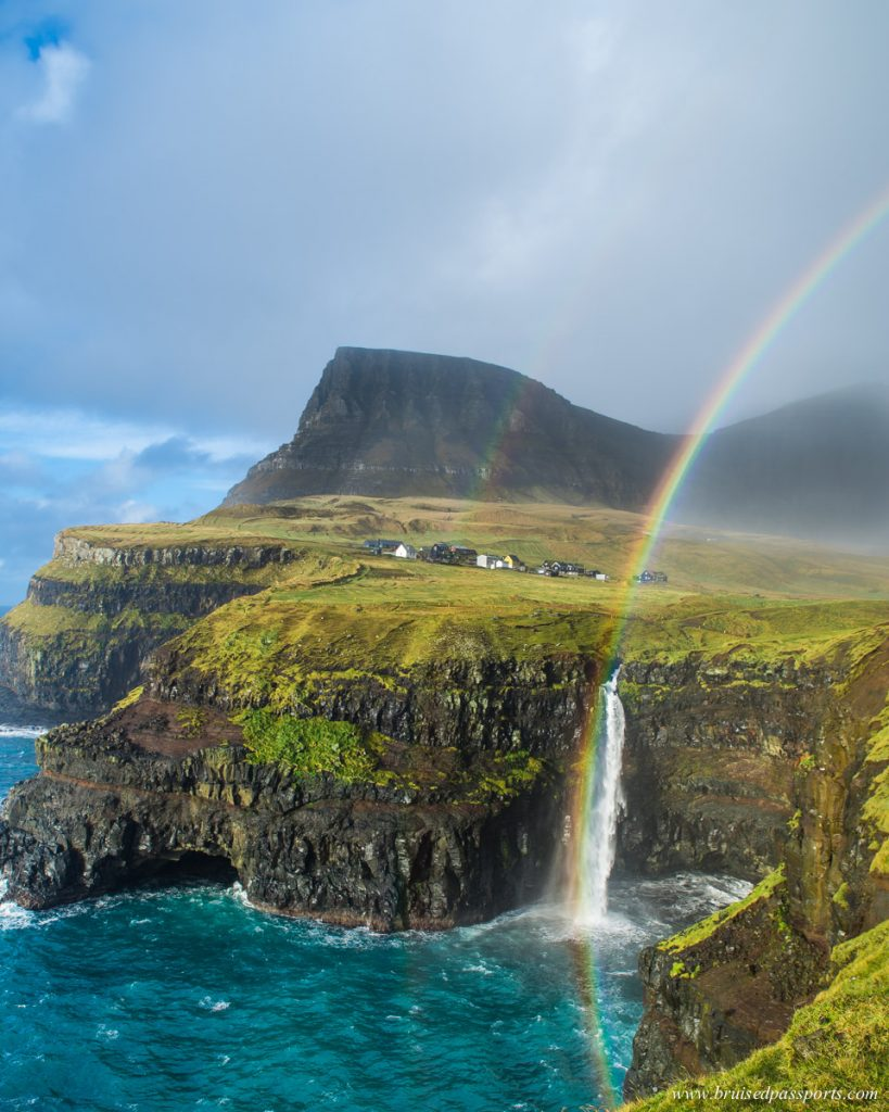 rainbow and waterfall under the village Gasadalur Faroe Islands