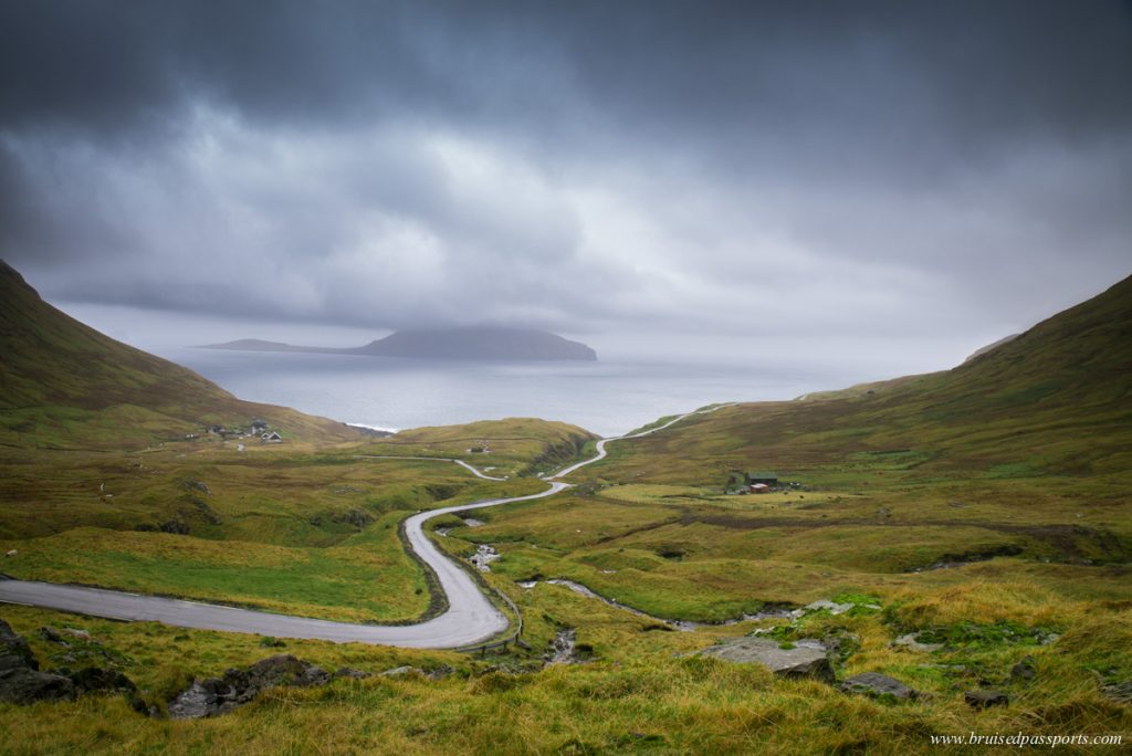 Winding road leading to Nordadalur in Faroe Islands