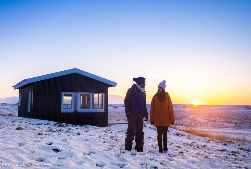 couple on winter road trip in Iceland
