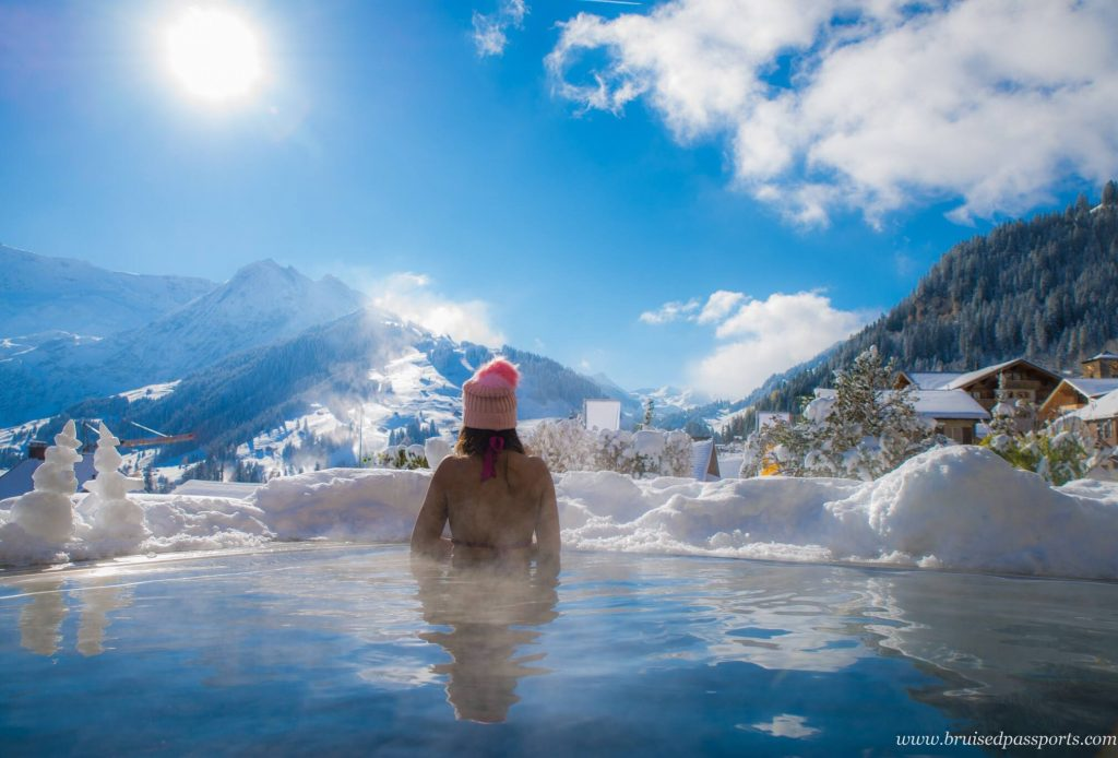 girl in infinity pool in switzerland