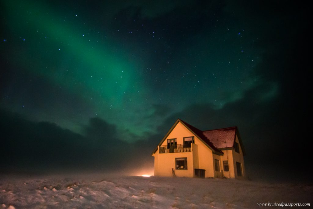 Northern Lights over a cottage in Snaefellsness Peninsula in Iceland