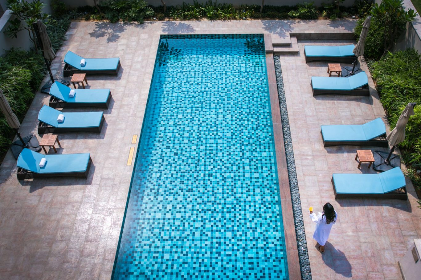 girl at pool at andaz delhi