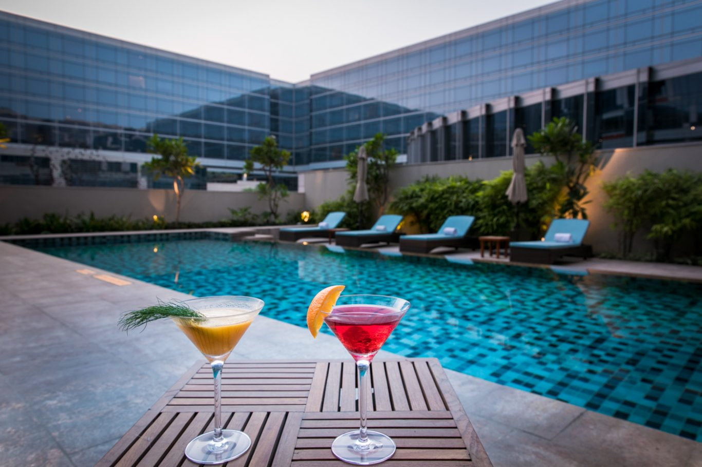 Cocktails by the pool at Andaz Delhi