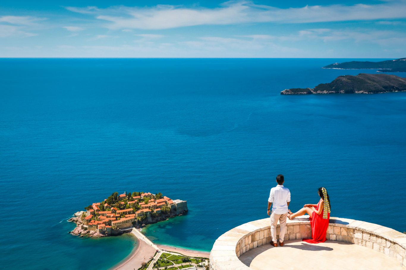 couple at Blizikuce church at vantage point of Sveti Stefan