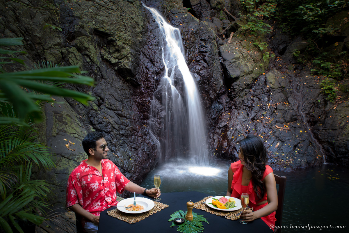 Couple having lunch by waterfall at Namale Resort and Spa Fiji