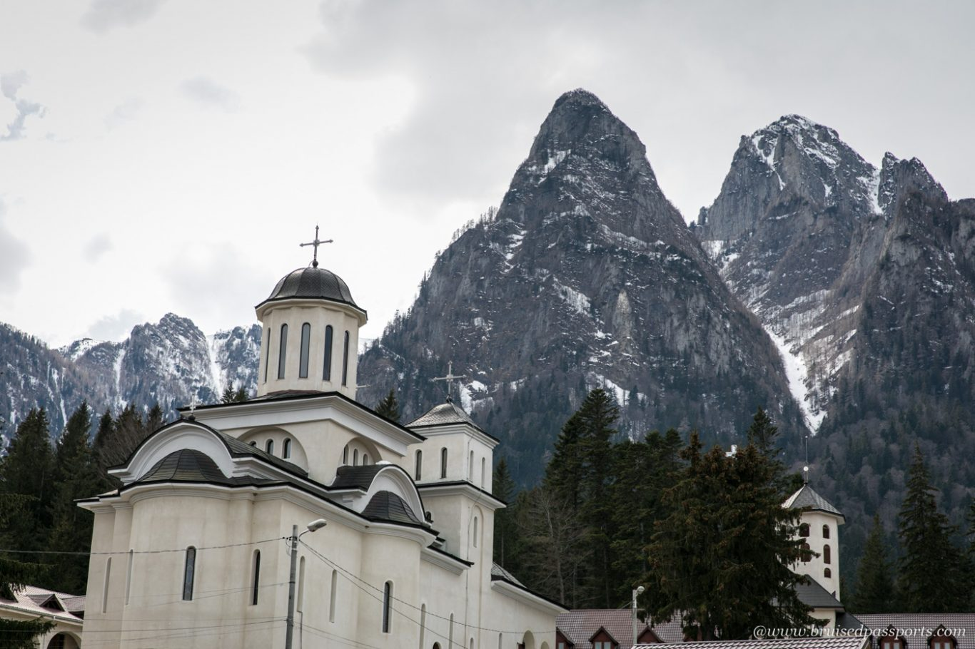 busteni monastery with towering mountains at the back