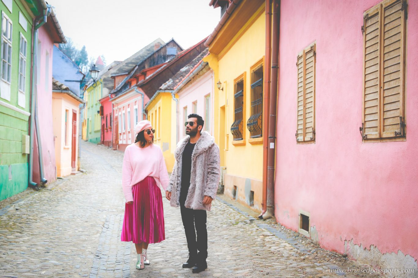 Couple in medieval city of Sighisoara in Romania