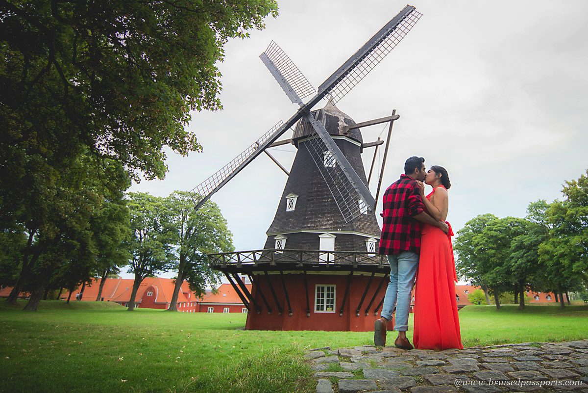 A couple near the windmill at Kastellet in Copenhagen
