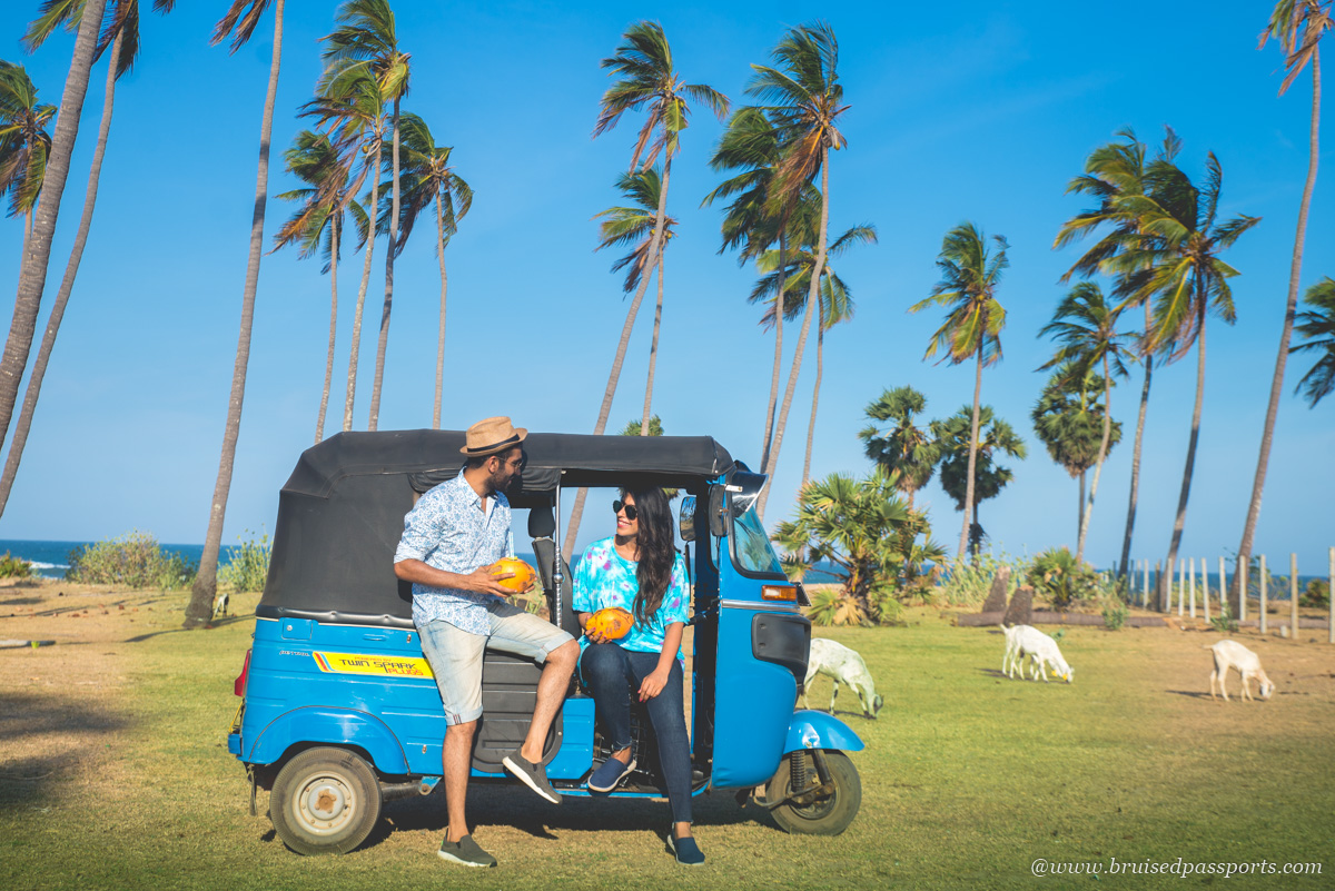 couple on a rented tuk tuk in Arugam Bay