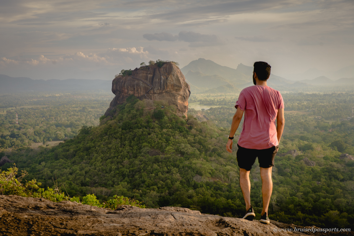 sunset at Pidurangala rock with view of Sigiriya rock