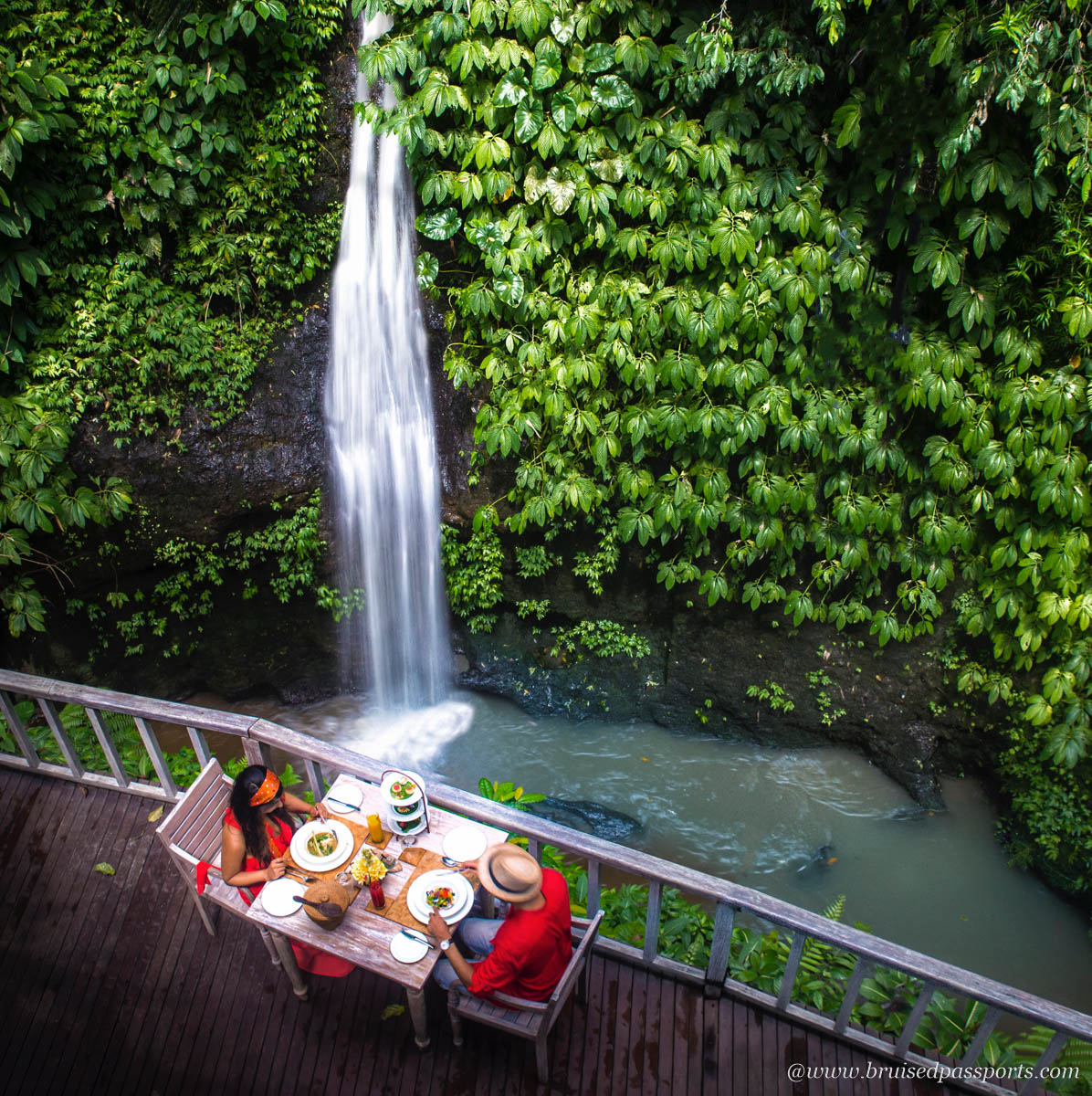Couple dining by a private waterfall in Bali