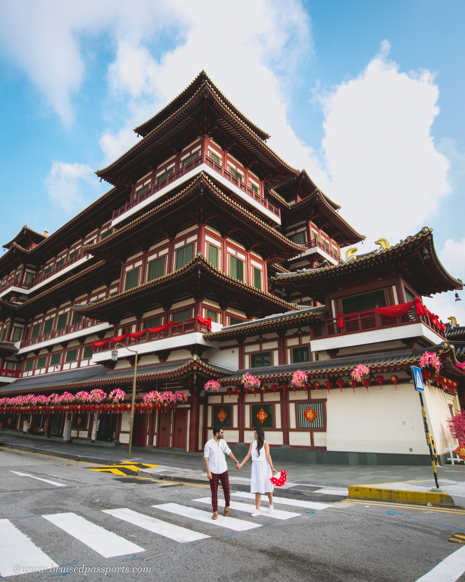 couple at tooth relic temple in Singapore's Chinatown